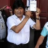 Bolivian President Evo Morales holds his ballot before voting in Villa 14 de Septiembre in the Chapare region, Cochabamba